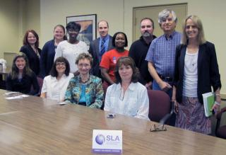 SLA President Deborah Hunt visits with OSTI Management and Staff