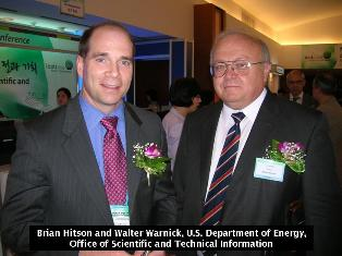 Walt Warnick and Brian Hitson shaking hands