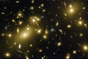Gravitational lensing, or the warping of light around massive objects is one sign of dark energy