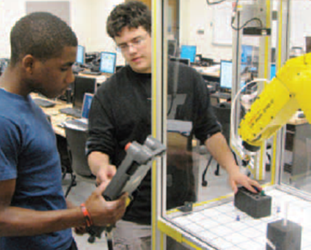 Students Trey Meeks and Marshall Wethy work in a robotics class lab (PDF)