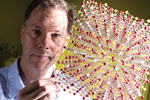 David Mandrus shows a model of the  perovskite crystal structure